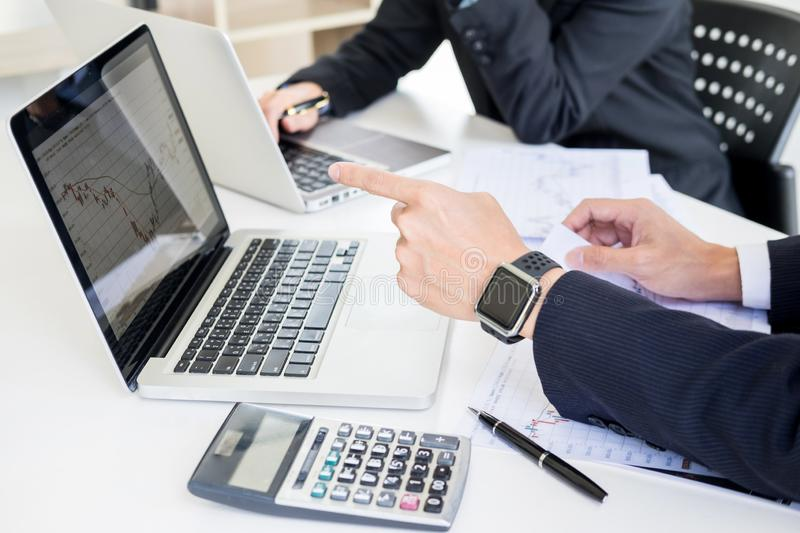 Business Team trader or broker Investment Entrepreneur colleagues working discussing and analysis graph stock market trading with. Forex chart data, financial royalty free stock photos