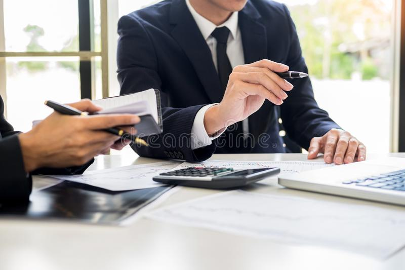 Business Team trader or broker Investment Entrepreneur colleagues working discussing and analysis graph stock market trading with. Forex chart data, financial royalty free stock images