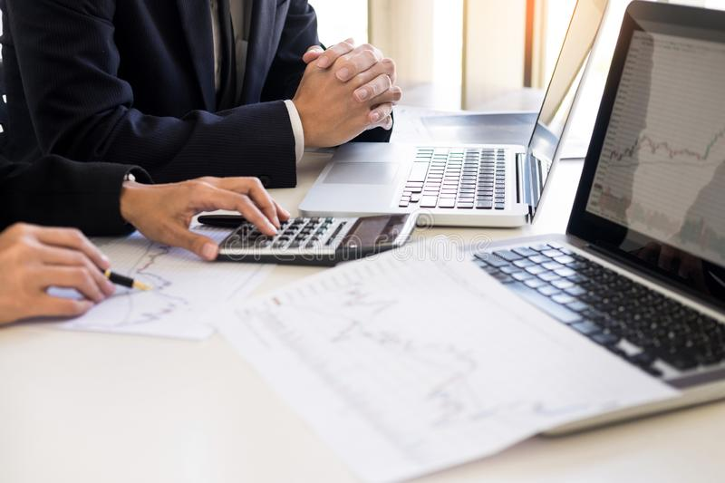 Business Team trader or broker Investment Entrepreneur colleagues working discussing and analysis graph stock market trading with. Forex chart data, financial stock image