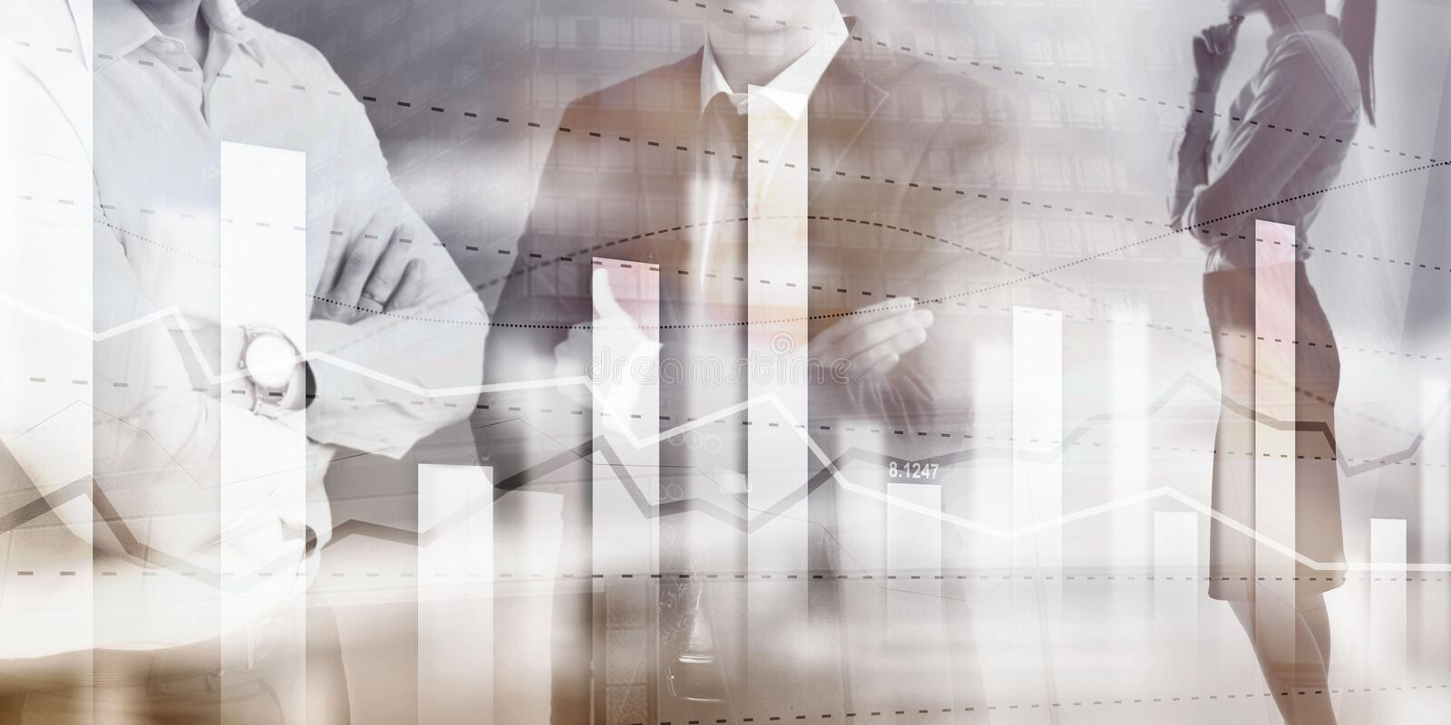 Business team traders investment planning and analyzing graph stock market trading with stock chart data.  royalty free stock photo
