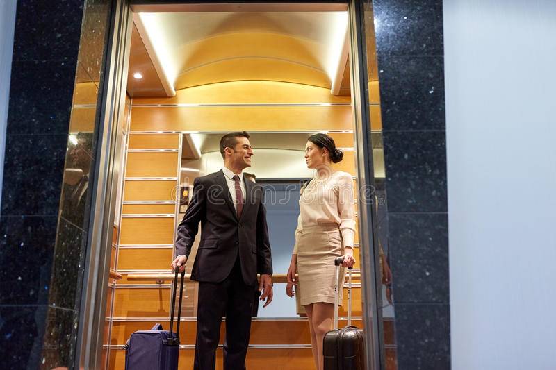 Business team with travel bags in hotel elevator royalty free stock photography