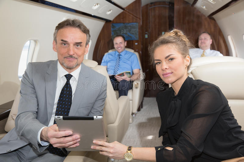 business team traveling in corporate jet and discussing a presentation royalty free stock photos