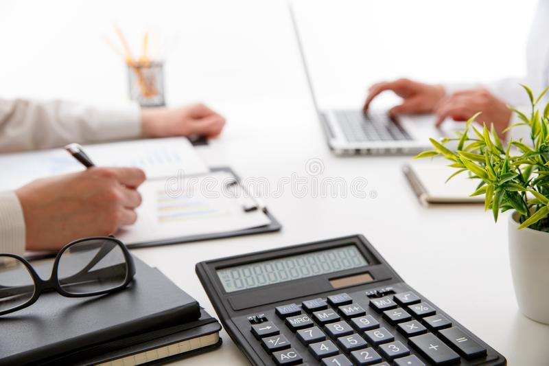 Business team two colleagues discussing new plan financial graph stock photography