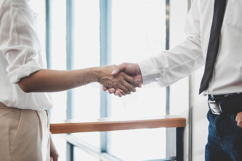 Business team two executive shaking hands after a meeting and conference to sign agreement and become partner in the office,. Results of their successful stock photography