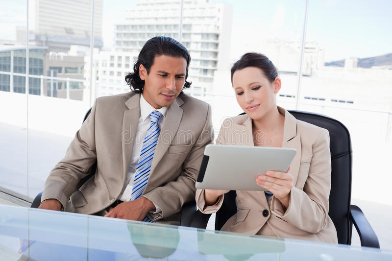 Download Business Team Using A Tablet Computer Stock Photo - Image: 22693952