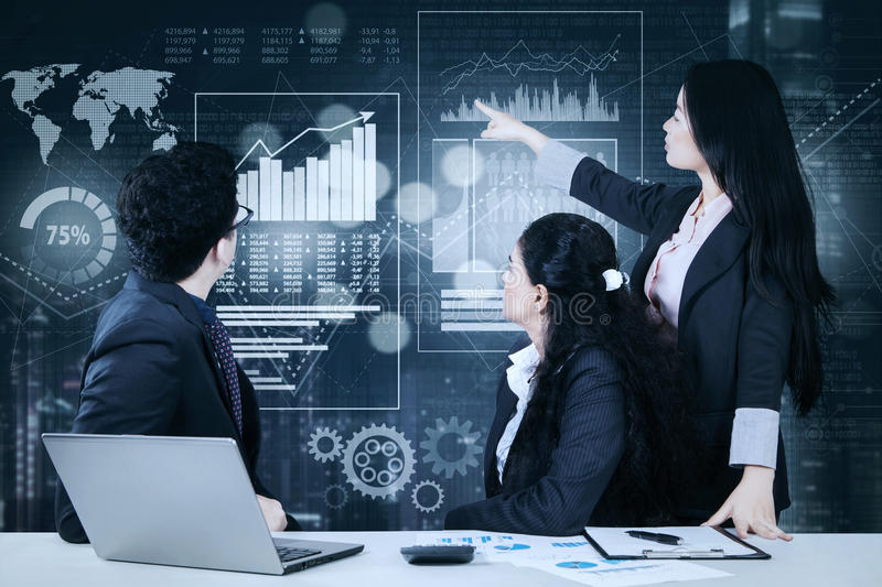 Business team with virtual finance chart royalty free stock image