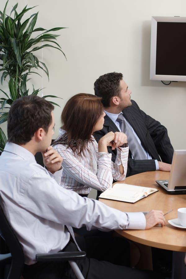Business Team watching tv stock photo