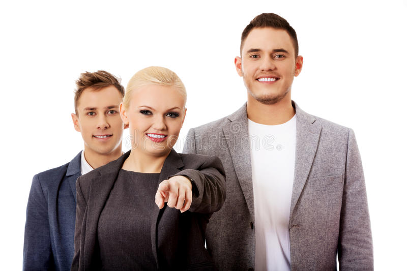 Business team-woman pointing at camera.  royalty free stock photography