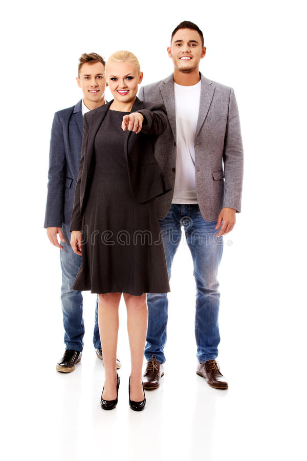 Business team-woman pointing at camera.  stock images
