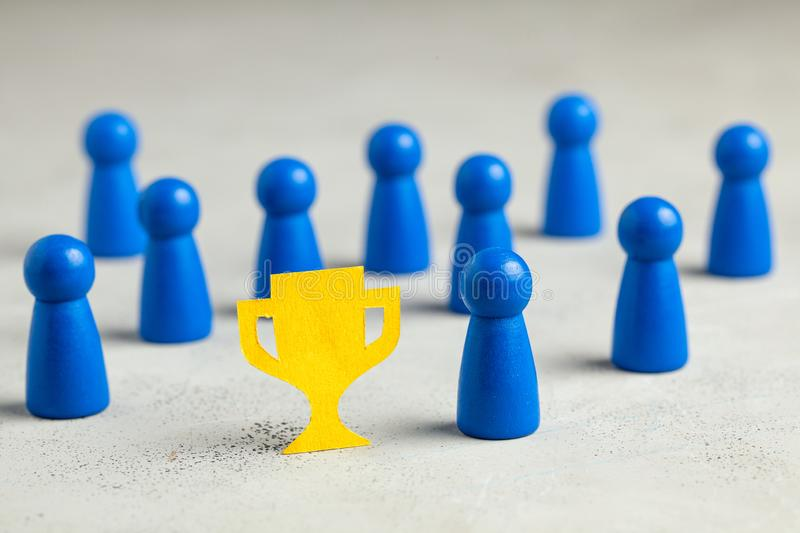 The business team won the cup. Winners with a cup as a symbol of success.  stock image