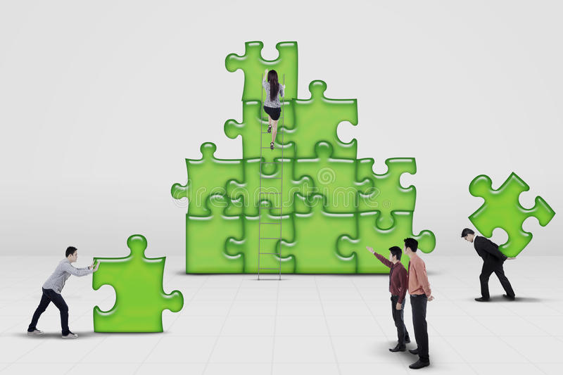 Business team work building a puzzle royalty free stock images