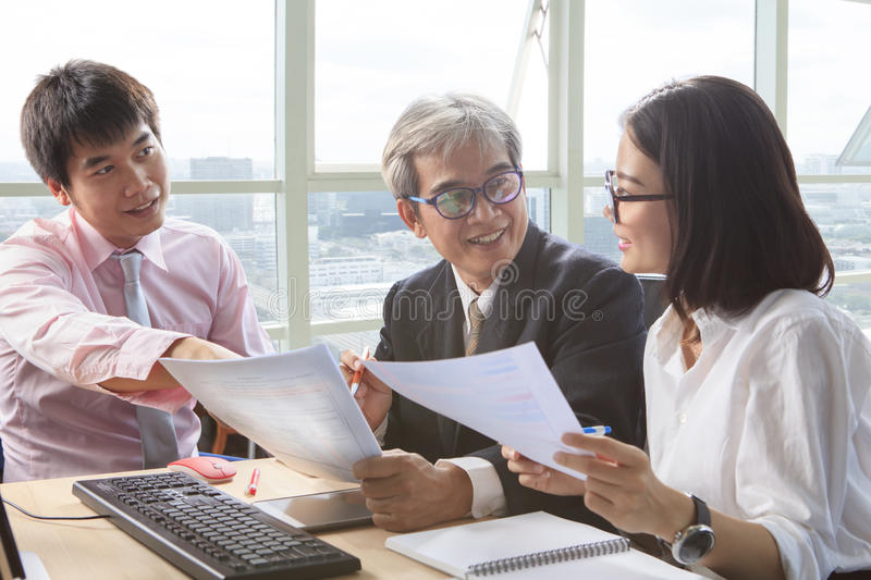 business team work meeting interview and explaining project solution discussing, on table meeting scene stock images