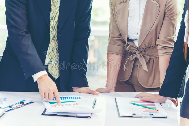 Business team work and partners discussing graph of financial in work space. royalty free stock photos