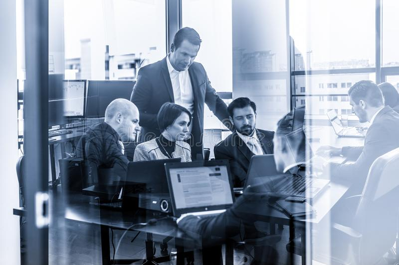 Business team working and brainstorming in corporate office. royalty free stock images