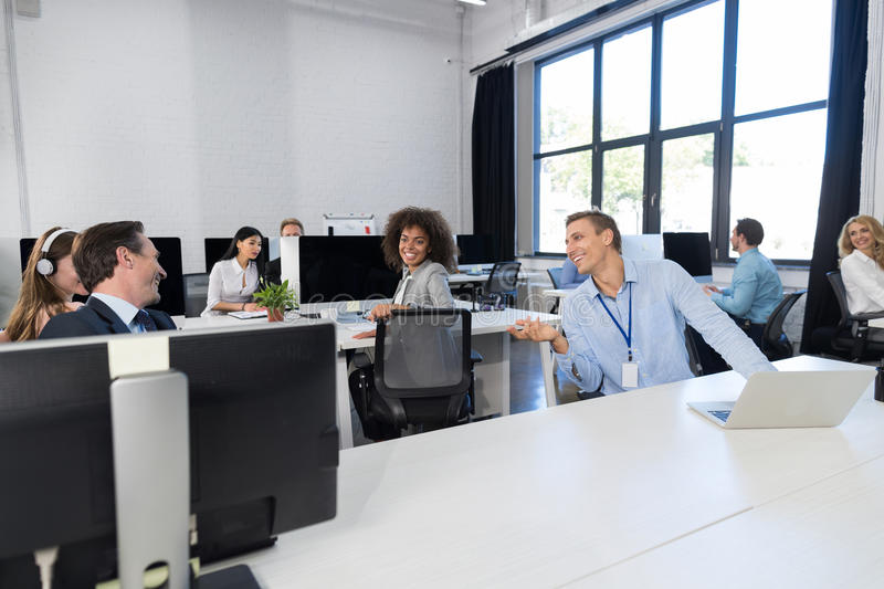 Business Team Working Concept Modern Open Space Office, Businesspeople Group Coworkers Sitting At Computers Talking On. Brake, Mix Race Colleagues Communication royalty free stock image