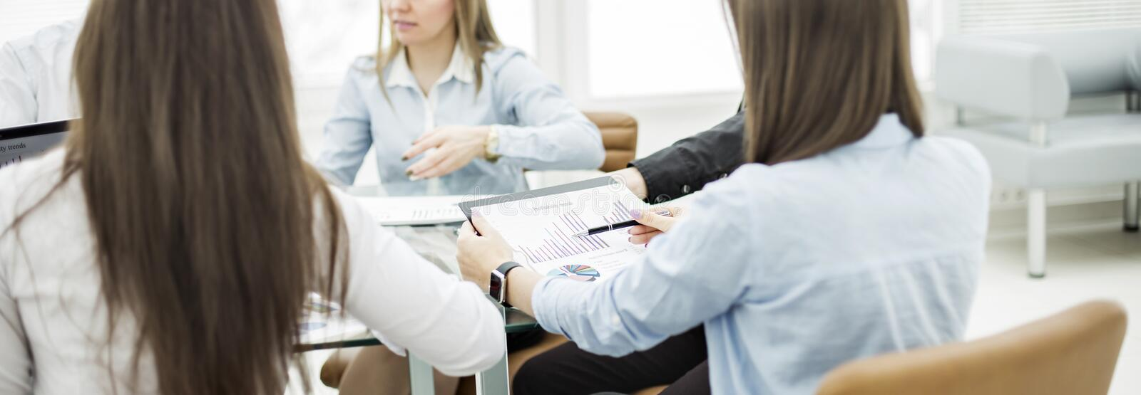 business team at a working conference sitting at a Desk and discussing important issues stock photo