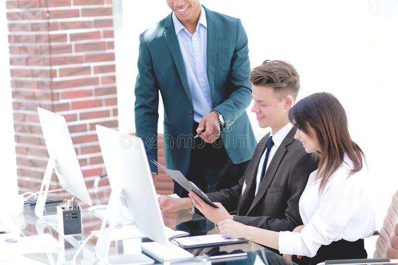 Business team working with documents in a modern office. royalty free stock image