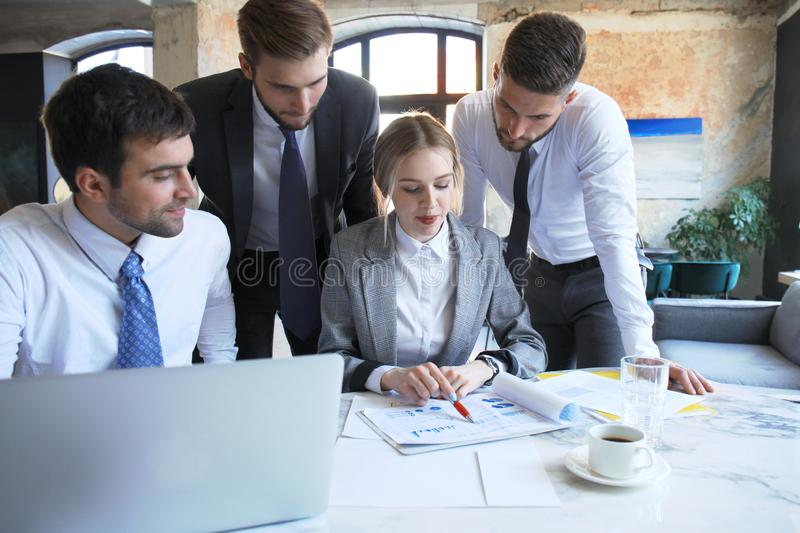 Business team working on laptop to check the results of their work royalty free stock image
