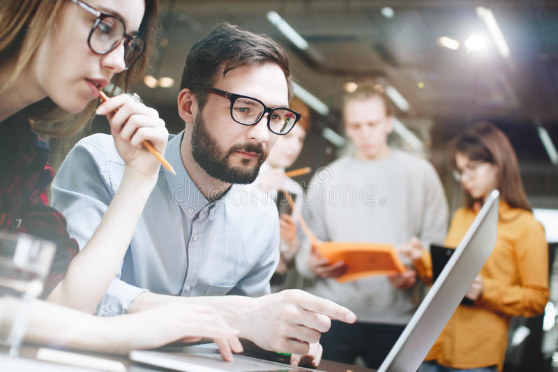 Business team working on a new project on a laptop. Discussion of a new work plan royalty free stock photo