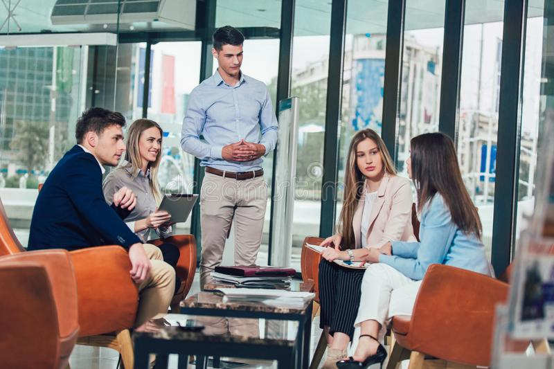 Business team working on new project and smiling. royalty free stock image