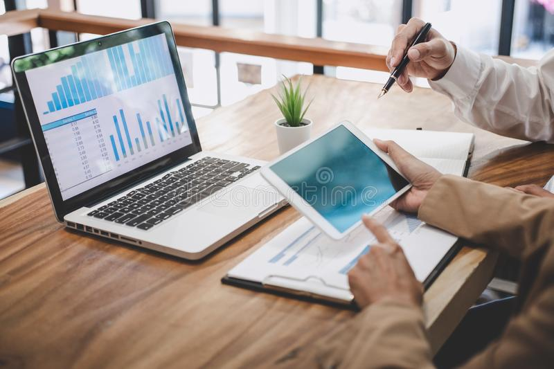 Business team working with new startup project plan and discussion information for financial strategy with laptop and digital stock images