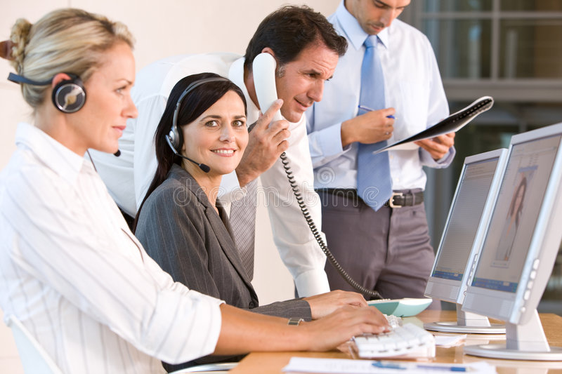 Business team working in office stock photos