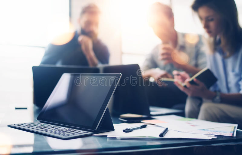 Business team at working process.Young professionals work with new market startup.Project managers meeting,mobile. Gadgets on the table.Panoramic windows on royalty free stock images