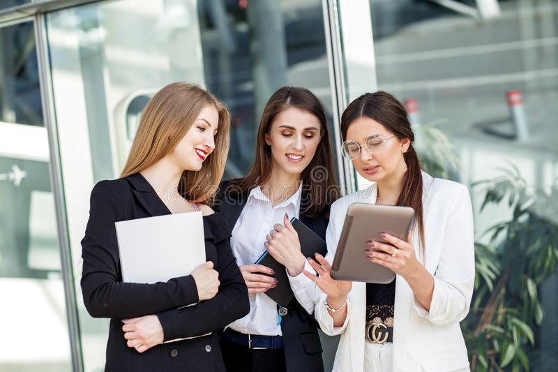 Business team working on a project. Business women at work. Concept for business, marketing, finance, work, colleagues and stock images