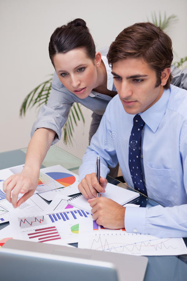 Business Team Working On Statistics Together Royalty Free Stock Photos