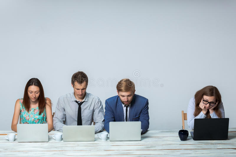 Business team working on their business project. Business team working together at office on light gray background. all working on laptops. copyspace image royalty free stock photos
