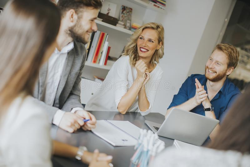 Business team working together in modern office stock image