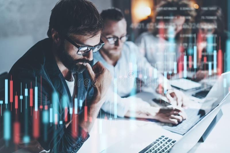 Business team working together at night office.Technical price graph and indicator, red and green candlestick chart and royalty free stock photos