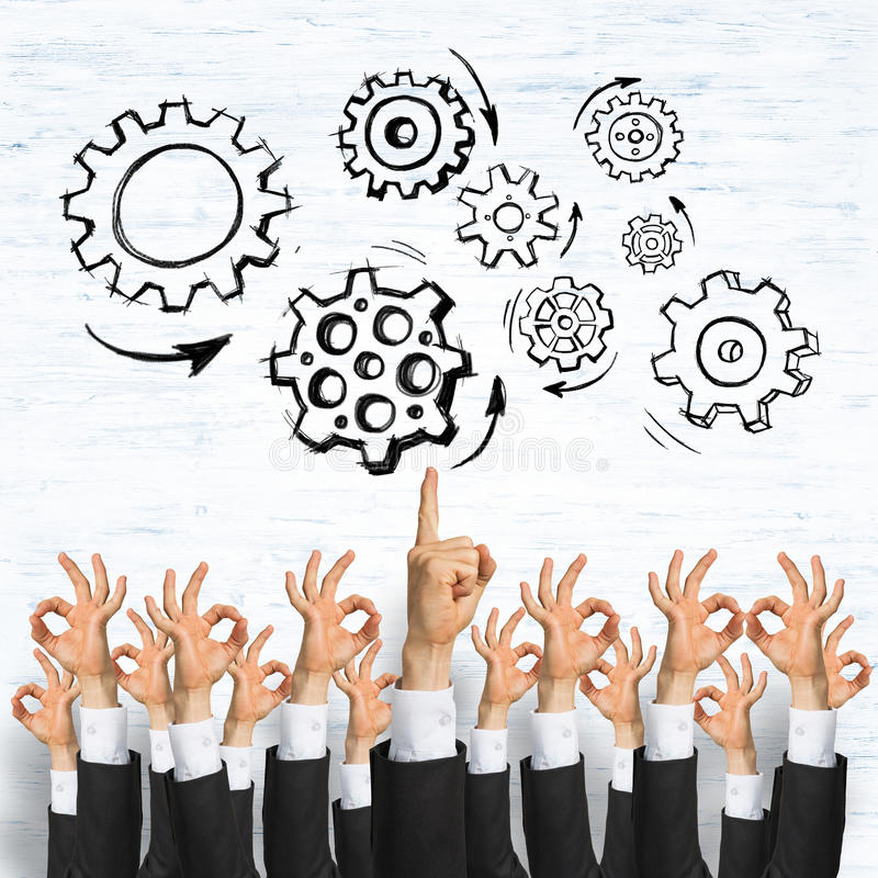 Business and teamwork concept. Group of hands of businesspeople showing gestures on wooden background stock image
