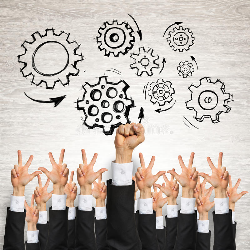 Business and teamwork concept. Group of hands of businesspeople showing gestures on wooden background stock photography