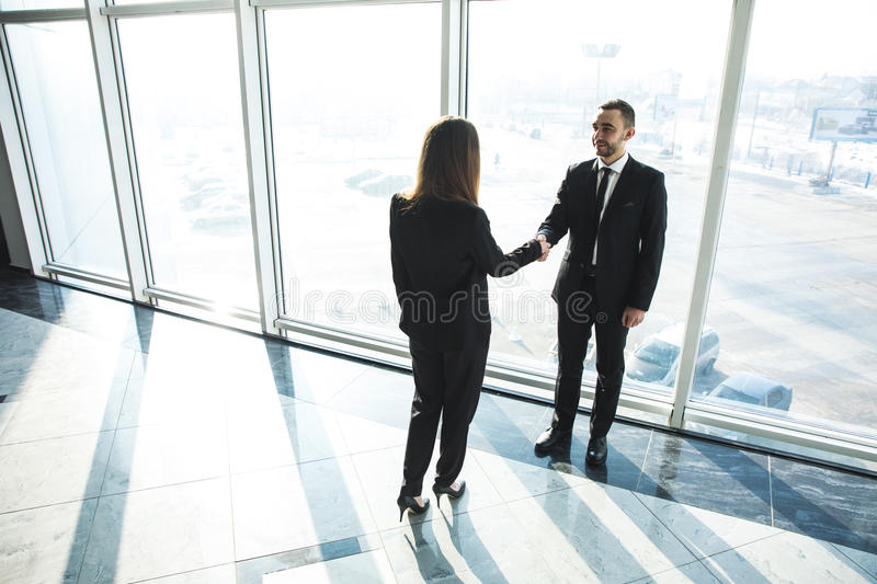 Business, teamwork, partnership, cooperation and people concept - business people shaking hands over panoramic office stock photos