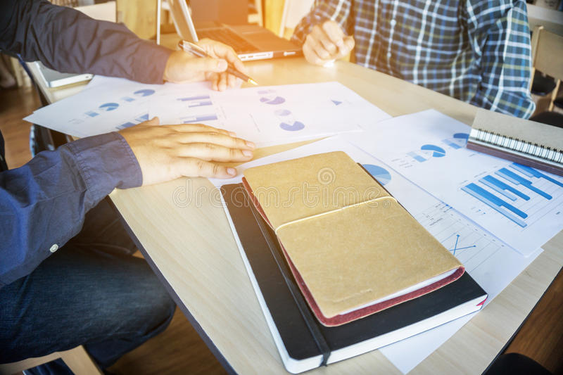 Business teamwork process, Businessmen hands pointing at document during explanation of new plan project data at meeting. royalty free stock image
