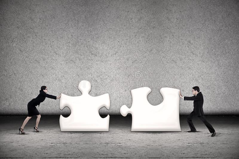 Download Business Teamwork Put Puzzle Together Stock Photo - Image: 27920238