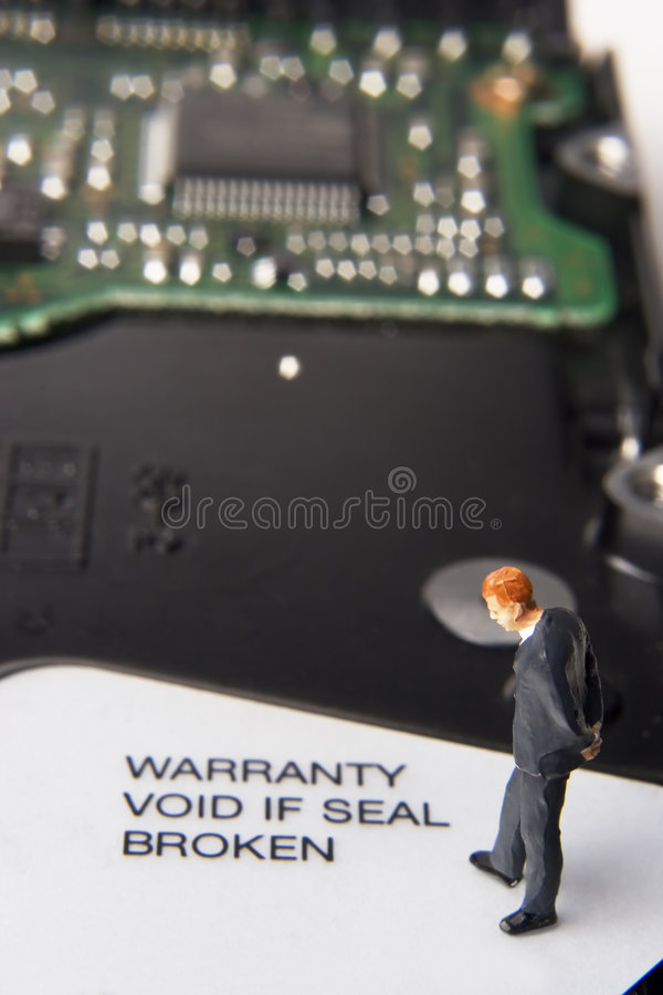 Business technology. Business figurine and computer component royalty free stock photos