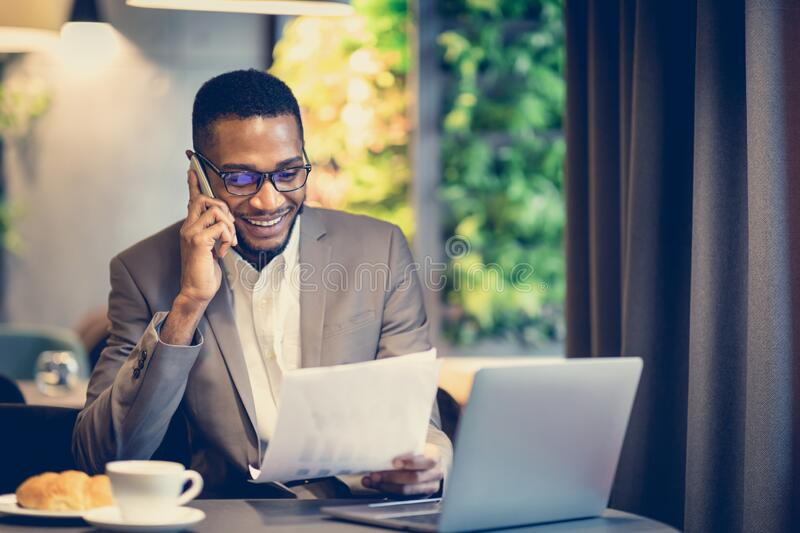 Portrait of afro businessman making phone call royalty free stock photos