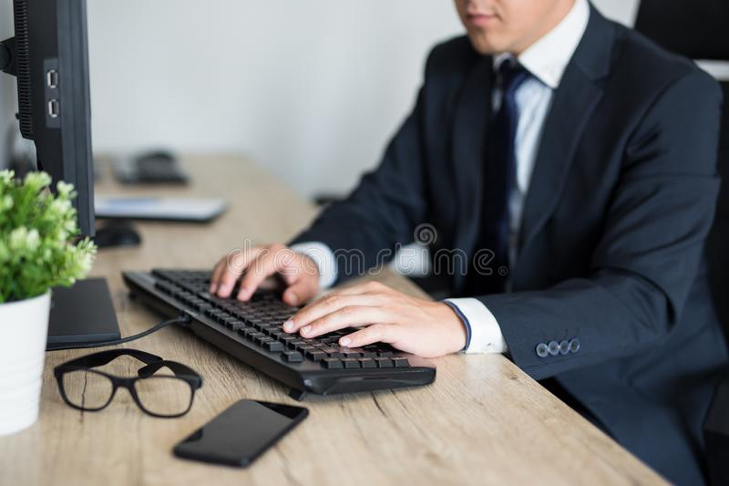 Business and technology concept - close up of male hands using computer stock photos