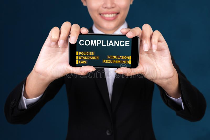 Business Technology concept, Happy businesswoman Show text Compliance on Smart Phone stock photos