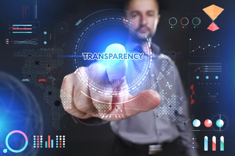 Business, Technology, Internet and network concept. Young busine. Ssman showing a word in a virtual tablet of the future: Transparency royalty free stock image