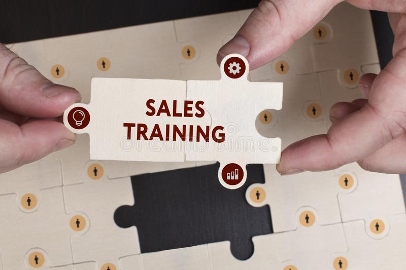 Business, Technology, Internet and network concept. Young businessman shows the word: Sales training stock photo