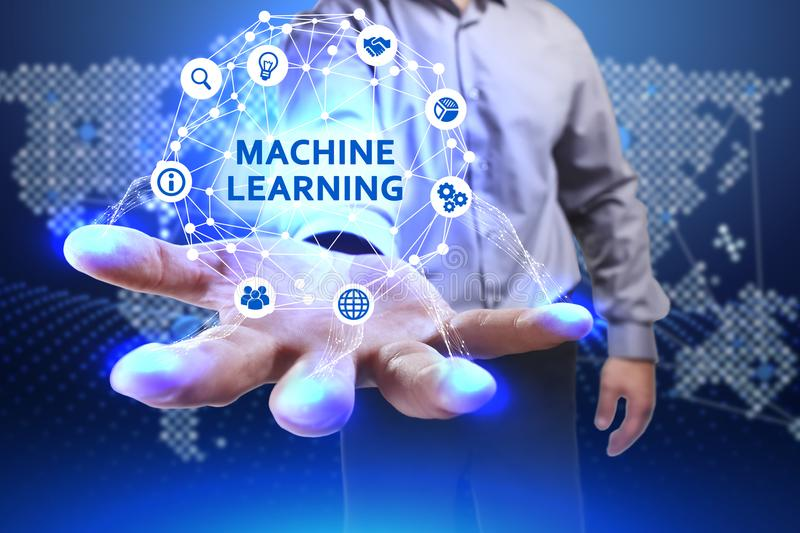 Business, Technology, Internet and network concept. Young businessman shows the word on the virtual display. Of the future: Machine learning stock photos
