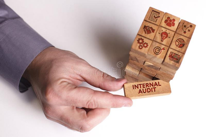Business, Technology, Internet and network concept. Young businessman shows the word: Internal audit stock photos
