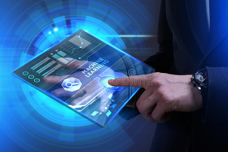Business, Technology, Internet and network concept. Young businessman working on a virtual screen of the future and sees. The inscription: Machine learning stock photo