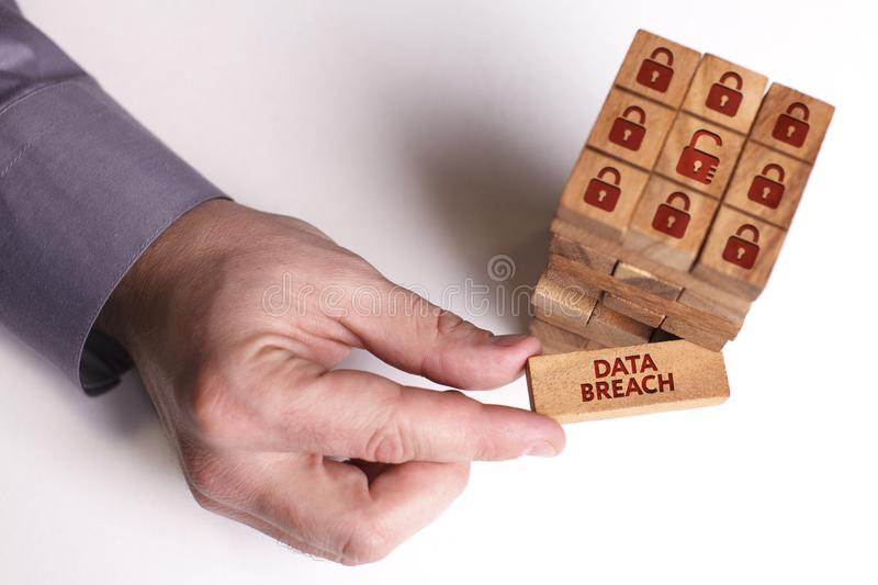 Business, Technology, Internet and network concept. Young businessman shows the word: Data breach stock images
