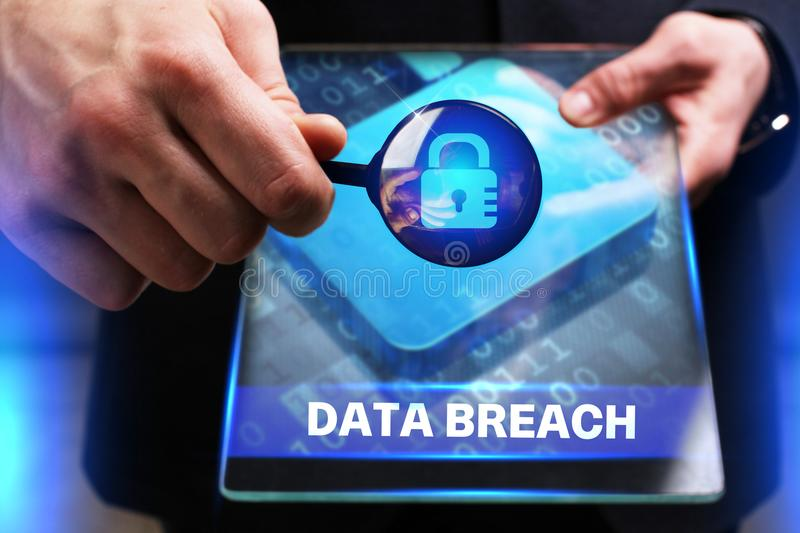 Business, Technology, Internet and network concept. Young businessman working on a virtual screen of the future and sees. The inscription: Data breach stock photo