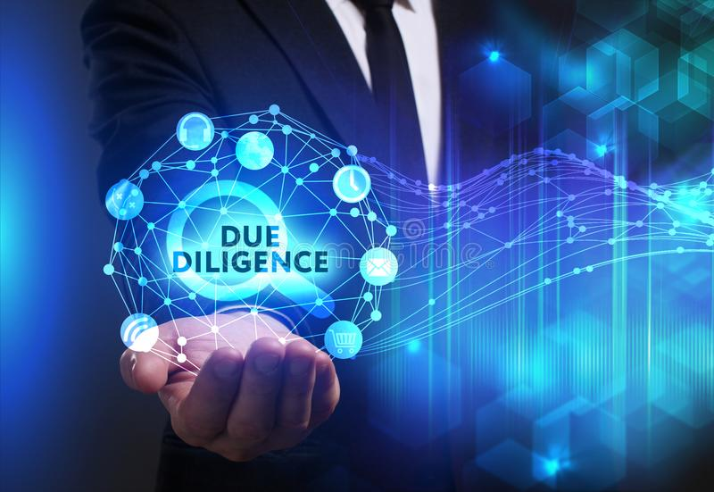 Business, Technology, Internet and network concept. Young businessman working on a virtual screen of the future and sees. The inscription: Due diligence stock images