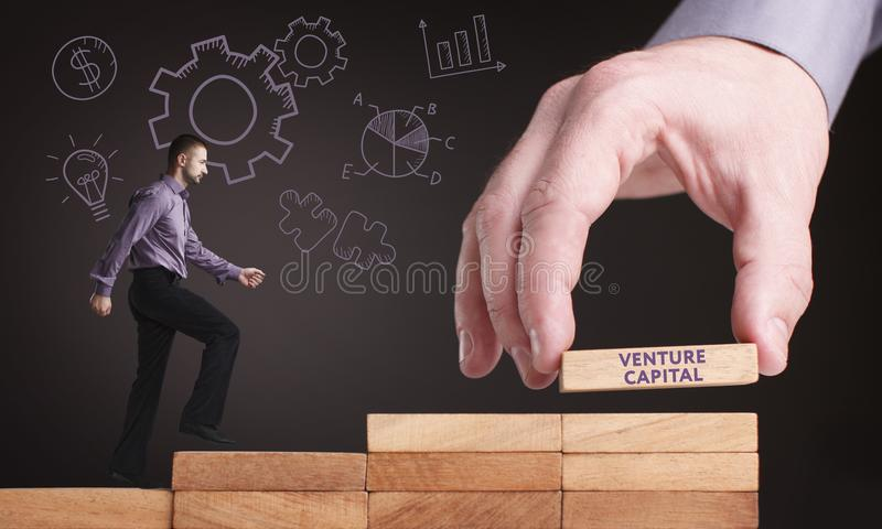Business, Technology, Internet and network concept. Young businessman shows the word: Venture capital stock photography